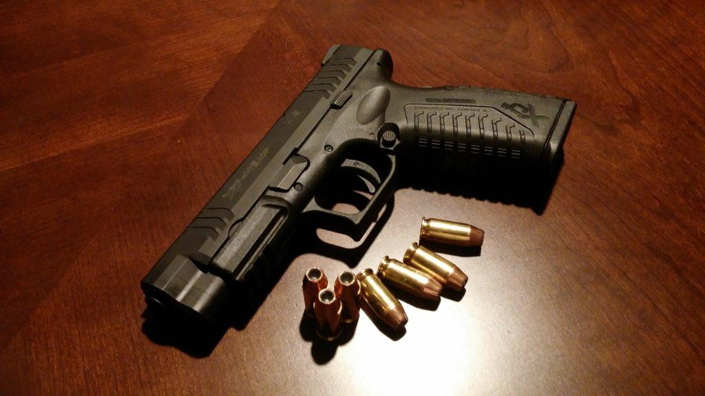 gun handgun red flag bullets law legal